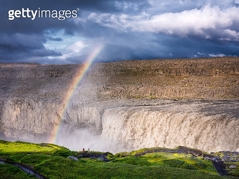 Dettifoss waterfall and rainbow, Iceland. Famous place in Iceland. A mountain valley and clouds. Natural landscape in summer. Travel - image.