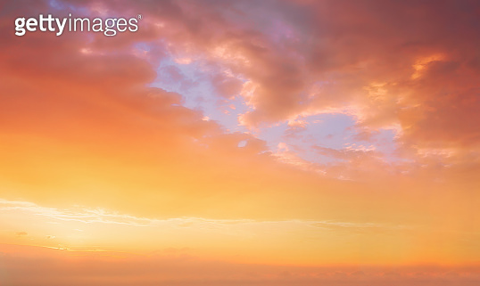 background of cloudscape with beautiful orange sunset clouds on sky