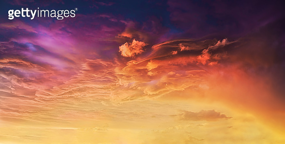background of amazing cloudscape with dramatic sunset clouds in sky