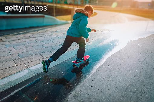 teenage boy riding skateboard outside, outdoor sport
