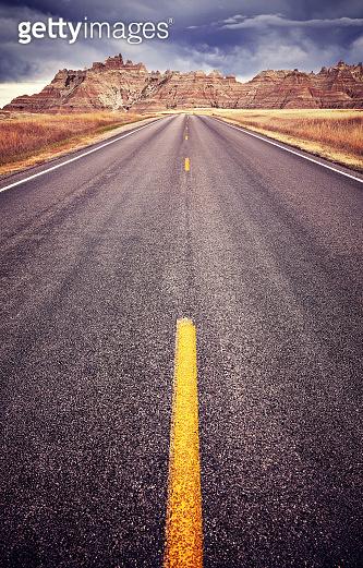 Asphalt road in Badlands National Park, USA.