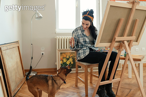 Female Artist with her Dog