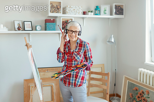 Female Artist Working on a New Painting