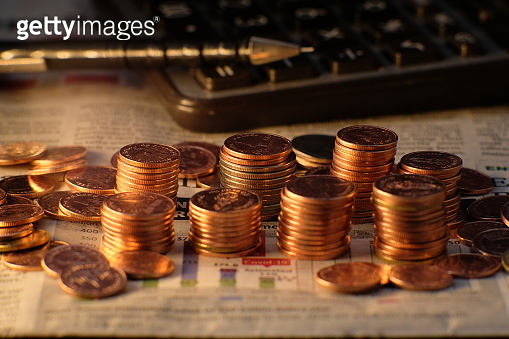 Stack of golden coins on black background and Advertising coins of finance and banking