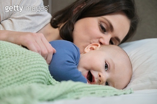 Portrait of beautiful young mother and her baby 7 month old son