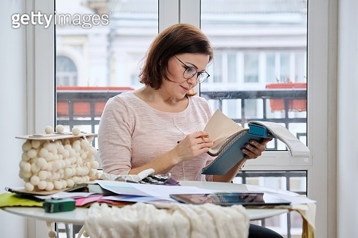 Adult female designer working with fabric samples