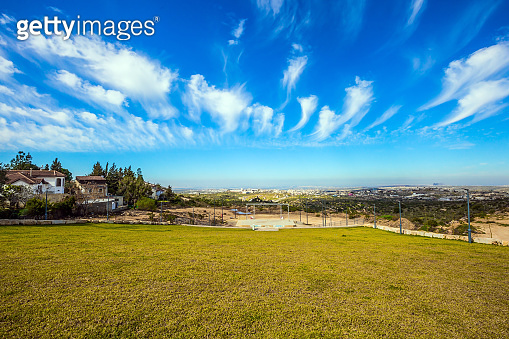 Green grass lawn in small village in Israel