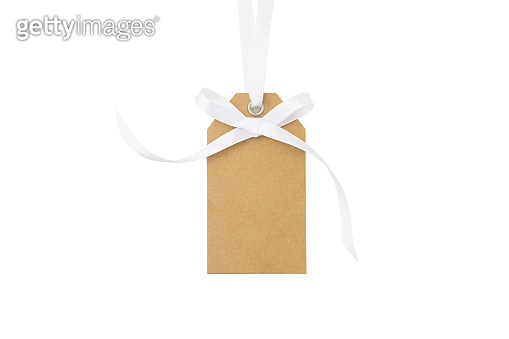 Gift tag with white bow isolated on white