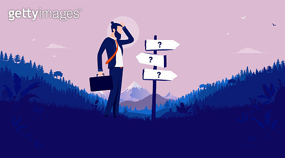 Business decision - Modern businessman standing in front of signpost showing different directions