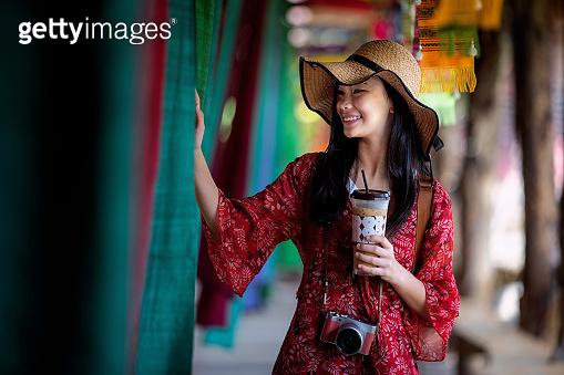 Asian girl fun and play in Lamduan woven cloth coffee shop in Pua