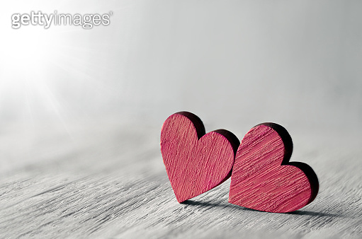 Valentine background with handmade hearts on rustic wood. Happy lovers day card mockup.