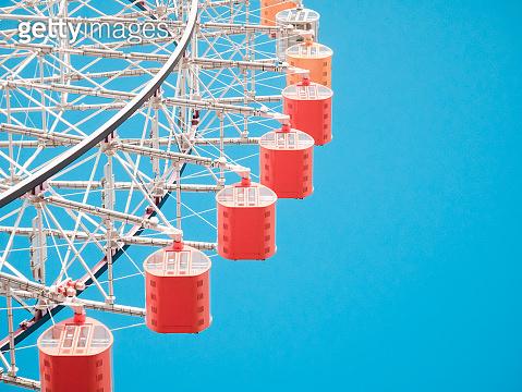 Ferris Wheel Over Blue Sky Background