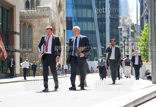Business people and office workers walking next to Lloyds building in the City of London during lunch time
