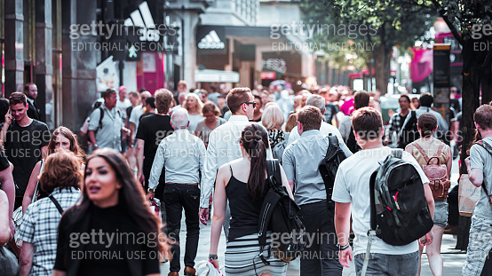 Lots of people walking in Oxford street, is the main destination of tourists and Londoners for shopping. London, UK