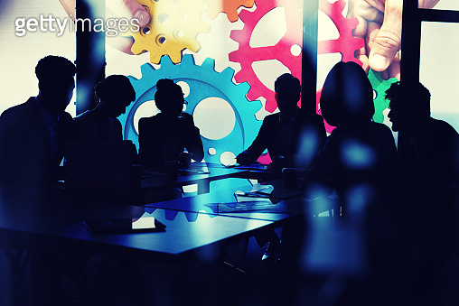 Business team connect pieces of gears. Teamwork, partnership and integration concept. double exposure with light effects