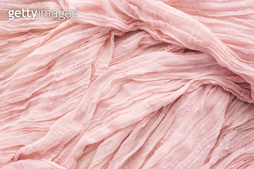 Texture fabric pink color for background.