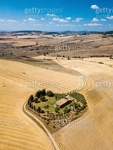 An earth shape farmhouse in Val d'Orcia, Tuscany, Italy