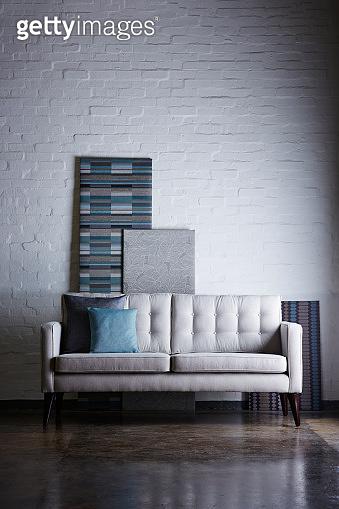 Modern sofa against white brick wall