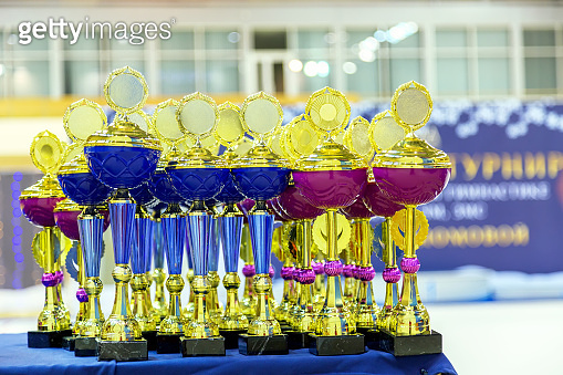 Group of the trophies or cups close up. Competition or championship concept.