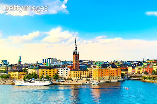 Beautiful panoramic view of Stockholm Old town Gamla Stan with a cruise ship. Summer sunny day in Stockholm, Sweden.