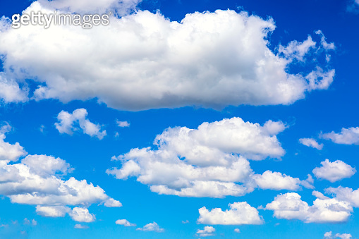 Blue sky background with clouds. Can be used as a natural background.