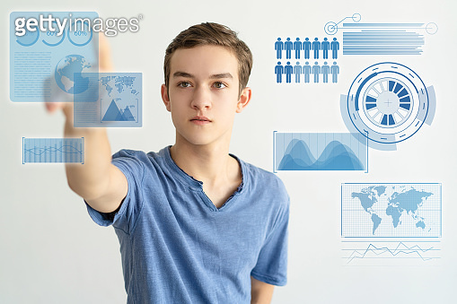 Serious concentrated young man using invisible touchscreen