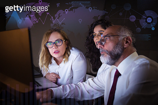 Serious people in eyeglasses and virtual statistic graphics