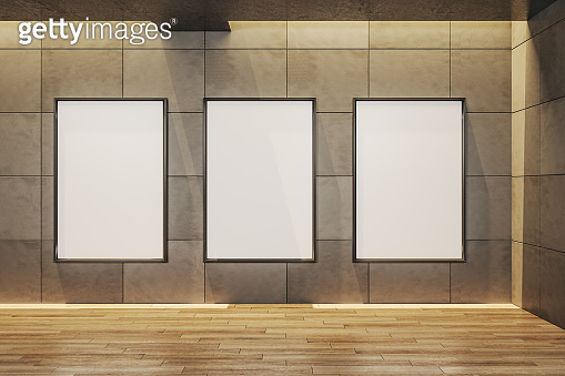 gallery interior with three empty billboard