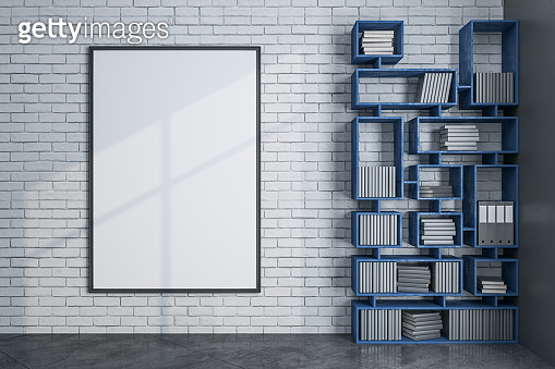 Loft library with bookcase and blank banner on wall.