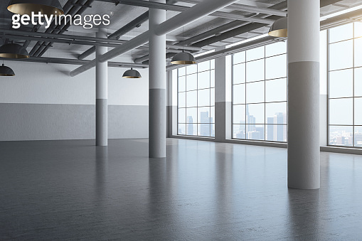 Concrete hall interior with columns and city view.