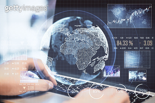 Businessman hand using laptop with abstract global network interface.