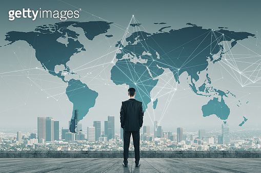 Businessman standing on roof with digital map