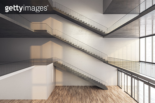 Modern staircase on concrete building interior.