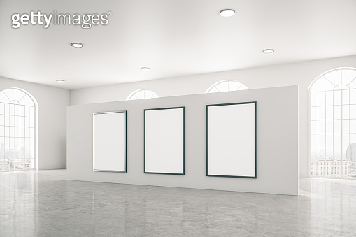 Bright gallery interior with three white banner