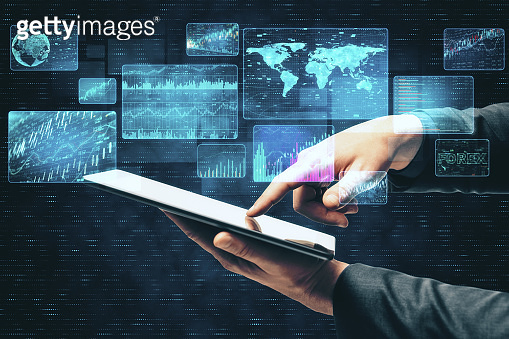 Businessman hand using tablet with business interface