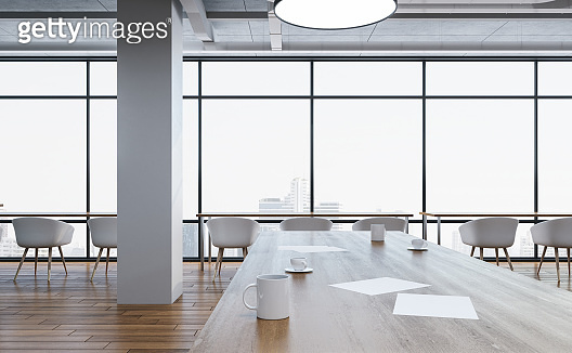 Modern office room with chairs and table