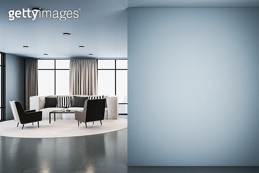 Living room with blank blue wall