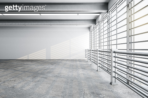 Contemporary gallery interior with empty wall