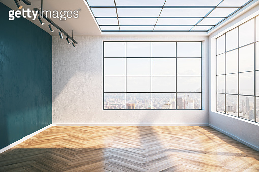 Sunny modern interior with wooden floor