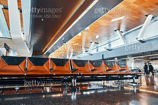 DOHA, QATAR - MARCH 27, 2020: Empty passenger seats in Hamad international airport
