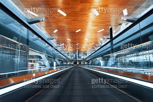 DOHA, QATAR - MARCH 27, 2020: Empty moving walkway in big modern Hamad international airport