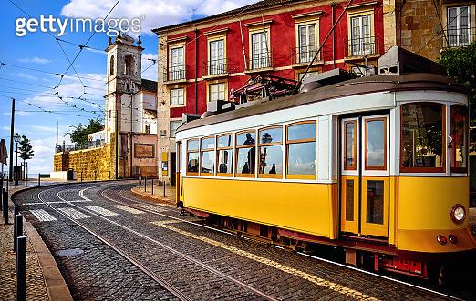 Lisbon Portugal. Yellow vintage tram driving.