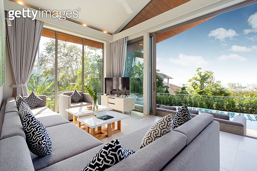 Interior design in villa, house, home, condo and apartment feature sofa, middle tale and television in living room with view
