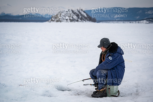 Fisherman on the Baikal lake in Siberia