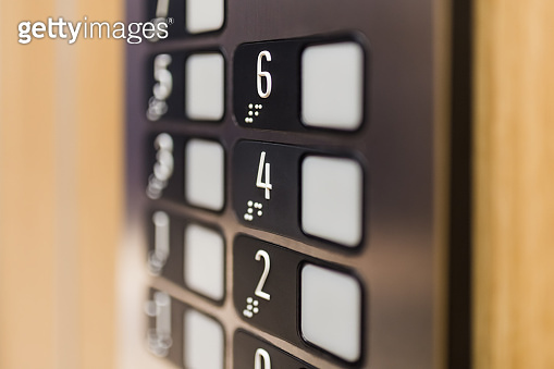 Close up of elevator control panel buttons.
