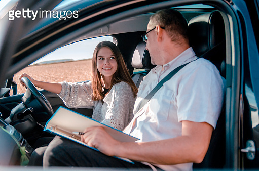 Driving school lesson in vehicle