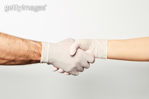 Two hands on a white background.