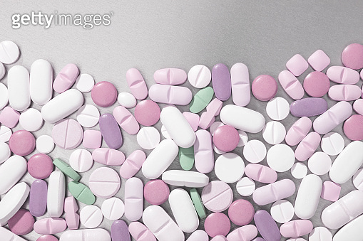 Close-up multi-colored pills and tablets background , full frame