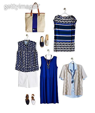 Fashionable clothing on coathanger isolated on white background