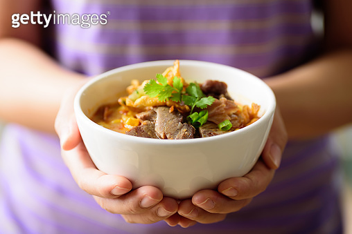 Traditional Local Northern Thai food (Khao Soi), spicy curry noodles soup with beef